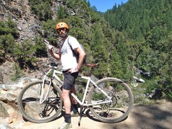 """6'6"""" DirtySixer founder riding the Downieville trails on the steel prototype."""