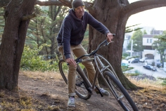 "6'6"" DirtySixer founder riding in MacLaren Park with the titanium prototype."
