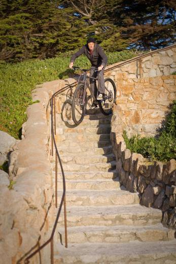 """6'6"""" founder of DirtySixer bikes going down stairs in Carmel, CA."""