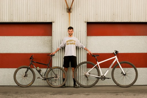 """6'10"""" Alex Leanse (one of our test rider) with his personal Surly Karate Monket XXL (yes it's a 29er) next to the Dirtysixer."""