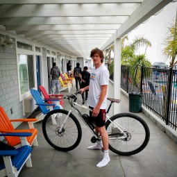 Dennis Clifford, 7-f tall Santa Cruz Warriors D-League player with the DirtySixer e-bike.