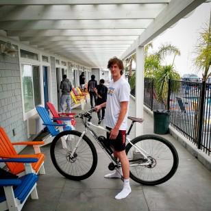 Dennis Clifford, 7-f tall Santa Cruz Warriors D-League player with the DirtySixer e-bike.
