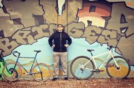 "Drew (6'8"") between a regular bike and the DirtySixer."