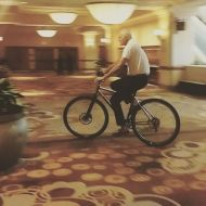 """Mark Eaton, 7'4"""" former Utah Jazz center, riding the proto DirtySixer 36er in the hallway of Las Vegas hotel during the NBRPA annual convention."""